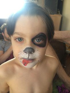 Artist Ariana- animal face painting and body art, hand or cheek art face paint