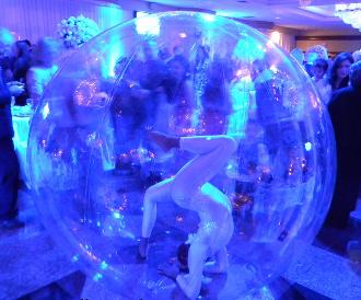 Gymnast inside inflatable bubble, can float on water at pool parties
