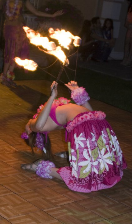 Emily- professional fire poi spinner dancer, fire fans, plumes, fire poi, Hawaiian Fire Show Pinao, exciting show mixing traditional Hawaiian hula with dramatic fire acts and audience participation, perfect for your Hawaiian Luau, beach party, summer party or corporate event
