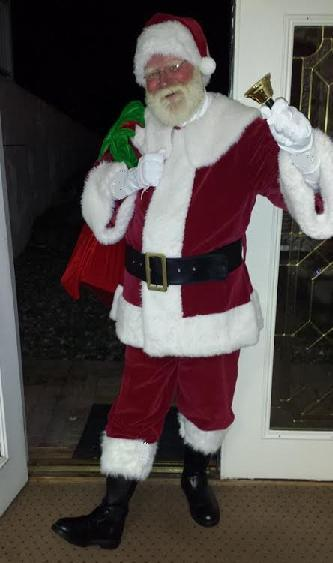 Santa John- professional children's entergtainer poses as the real Santa Claus, real bearded Santa for children's Xmas themem birthday parties, holiday shows, and corporate events, real bearded Santa for Xmas Eve and Christmas Day house call visit