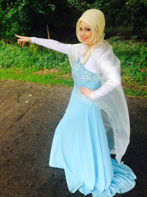 Ice Princess Julie poses as the frozen Ice Queen for kids parties, includes make-a-wish snow dust, snowman puppet, magic, singing, dancing, wintery theme treasure hunt, childs little sister costume, frozen theme stickers, balloon art, with optional amazing frozen theme face painting
