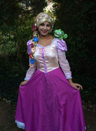 Princess Loren poses as Tower Princess Rapunzel for woodland themed birthday party show
