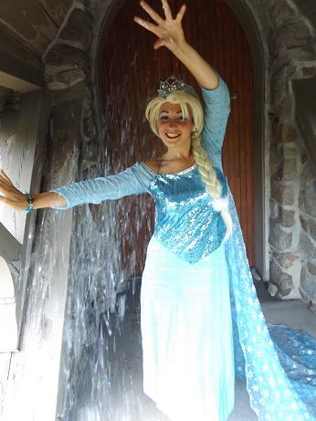 Princess Lucy- professional actress, singer, and dancer poses as frozen Ice Princess with make-a-wish snow dust and artic theme birthday party show, frozen Ice Queen Princess birthday party entertainer in New Jersey