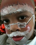 Professional holiday face paitning for kids parties, corporate events, and family holiday gatherings