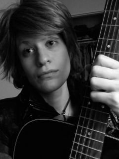 Bon Jovi impersonator look alike performs mock rock show singing Bon Jovi favorite hits with music and guitar, for kid's and family parties,corporate events, stage shows, bar bat mitzvahs, for any ocassion