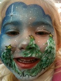 Christmas holiday themem face painting for children's birthday parties, holiday events, and frozen princess theme parties