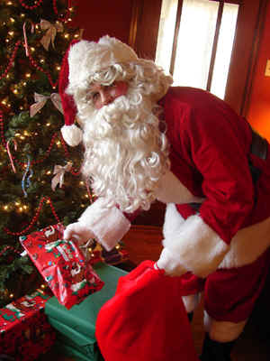Visit from Santa Claus, professional children's performer delivers your gifts or party favors, pose for photos, holiday show, candy canes, puppet, caroling, storytelling